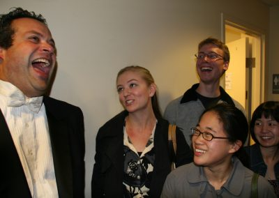 berick laughs backstage with students